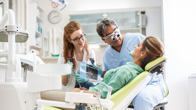 A patient receiving a dental exam.